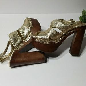 Gold open toe shoes
